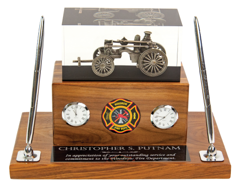"Antique steam fire pumper embedded in clear acrylic, mounted on solid walnut base; includes 2"" medallion, clock, hygrometer, and two pen set."