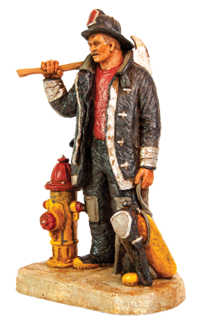 Michael Garman Fire fighter sculptor with axe on shoulder, standing next to a fire hydrant.