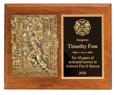 Antique finish casting mounted on a plaque with engraved plate and 10 perpetual plates.
