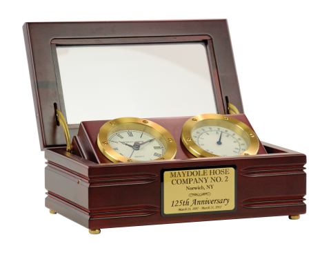 Clock and thermometer are set in beautiful satin finish mahogany wood case with glass lid featuring brass hinges and fittings.