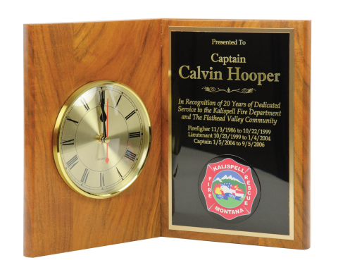 "Solid walnut book plaque 9 ½"" high with 5"" quartz clock and brass engraving plate."