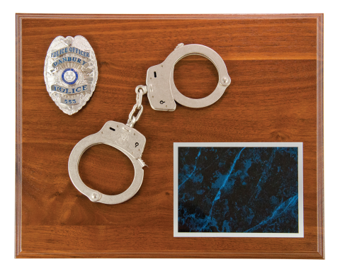 Solid walnut plaque includes handcuffs and premium aluminum engraved plate with silver letters to accent silver cuffs. Room to mount recipient's badge.