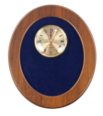 "Solid walnut oval frame with rich velvet backing accents 4"" quartz clock and brass engraved plate."