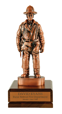 Copper finished firefighter on a solid walnut base with copper finished brass engraving plate.