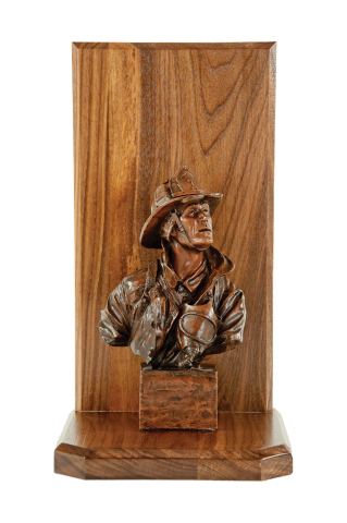 The Original Firefighter sculpture mounted on a walnut base with engraving plate