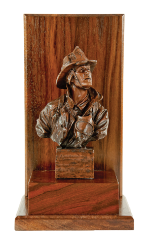 "he Original Firefighter sculpture 7.5"" mounted on a walnut block with base and background with engraving plate"