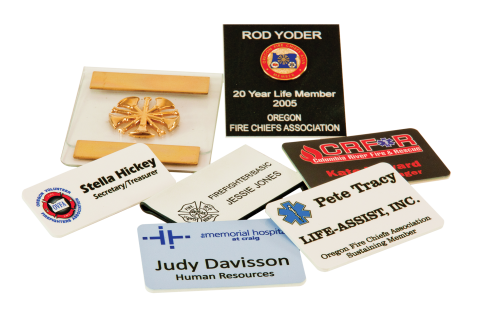 Name badges of various styles.