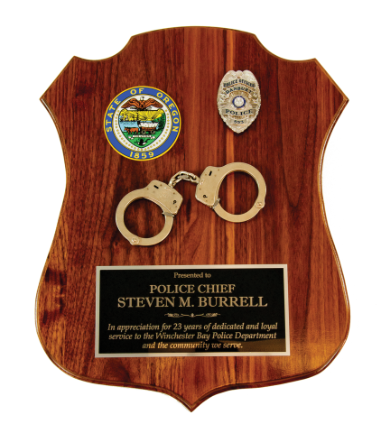 "2""x15"" solid walnut plaque with engraved plate and handcuffs is customized with your department's logo and individual officer badge"