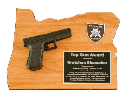 Solid red alder plaque in the shape of your state, matte black gun replica mounted,