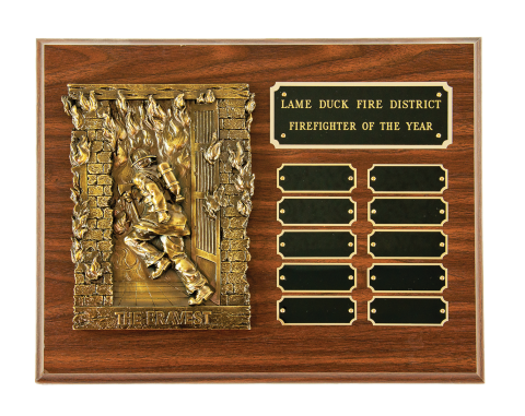Antique finish casting mounted on plaque with engraved plate and 10 perpetual plates.