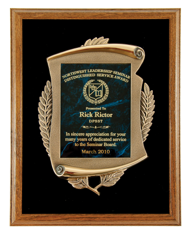"Solid oak frame with black velvet background, bronze finish ""The Bravest"" and brass engraving plate"