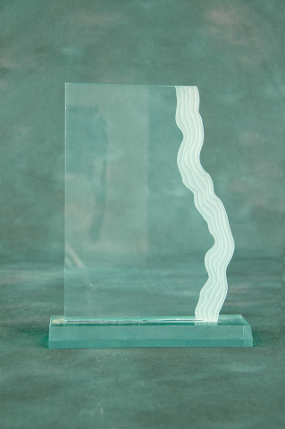 Graceful waterfall edge accents clear or jade acrylic piece on acrylic base