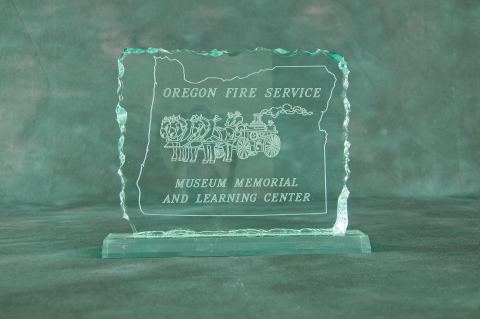 Clear acrylic plaque (8×10) with cracked ice edge and acrylic base. Reverse engraved on the back with your message and department logo.