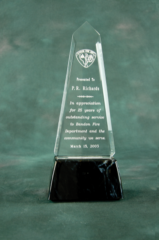 This elegant shape is a unique recognition award, mounted on a black marble finished base.